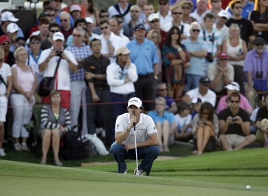 McIlroy lines up a shot on the 18th hole during the second round of the Dubai World Championship.