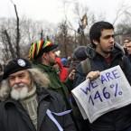 A protester hold a home-made sign (AP Photo/Sergey Ponomarev)