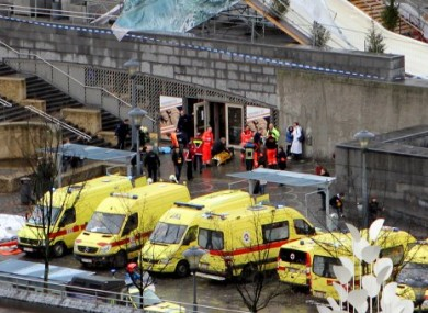 Emergency services on the scene of the attack in Liege today.