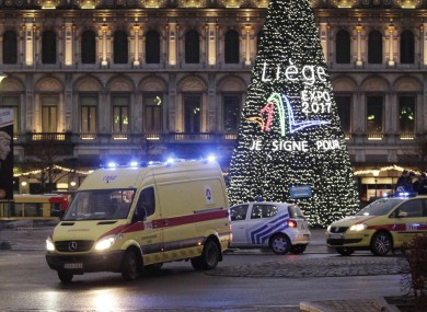 An ambulance leaves the scene after yesterday's shootings in Place Saint-Lambert, Liège, where four people were killed. Six people in total died in yesterday's attack.