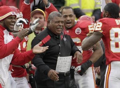 Kansas City Chiefs head coach Romeo Crennel celebrates with his team.