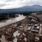 An aerial photo showing the damage caused by devastating floods over Iligan City on 19 December, 2011, two days day after Typhoon Washi wrought havoc in the city. (AFP PHOTO/POOL/RICHEL UMEL/PA Images)