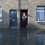 Martin Murphy surveys the damage to his house in Kilmainham in Dublin after the Camac River burst its banks and flooded during severe rain on 24 October. Two people lost their lives in the flooding - nurse Celia de Jesus and Garda Ciarán Jones. (Leon Farrell/Photocall Ireland)
