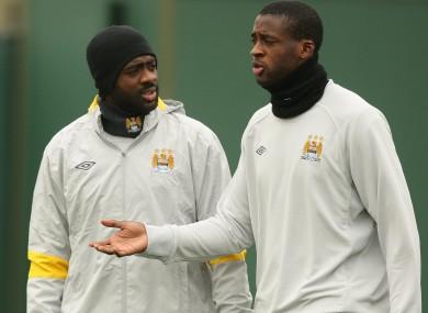 Manchester City's Kolo (left) and Yaya Toure.