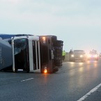 A lorry lies on its side after being blown over in high winds on the A66 in County Durham earlier today. (Image: PA Photo/Owen Humphreys)
