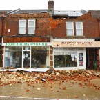 Debris lies on the pavement after it fell from the front of two shops in Shirley, Southampton. (Image: Chris Ison/PA Wire)