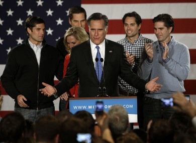 Romney, flanked by his wife and sons, at a 'victory' rally in Des Moines, Iowa last night.
