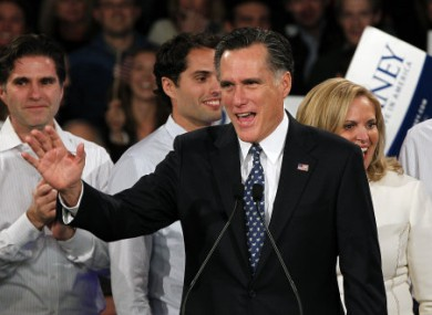 Mitt Romney greets supporters at last night's primary.