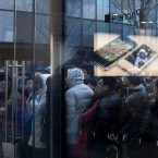 People queue outside an Apple store to purchase the iPhone 4S model in Beijing. (AP Photo/Andy Wong/PA Images)
