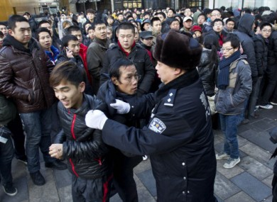 Police pulling people away from the Apple store in Beijing this morning.