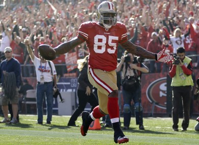 San Francisco 49ers tight end Vernon Davis takes the ball into the endzone for a touchdown.