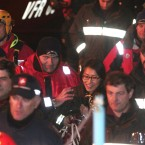 A passenger from South Korea, centre, walks with Italian firefighters after being rescued from the luxury cruise ship Costa Concordia. (AP Photo/Gregorio Borgia/PA Images)