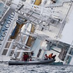 Italian Firefighters and scuba divers approach at the Costa Concordia as the search for survivors continued on Sunday. (AP Photo/Gregorio Borgia/PA Images)