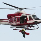 An Italian firefighter helicopter lifts up a person from the luxury cruise ship Costa Concordia. (AP Photo/Gregorio Borgia/PA Images)