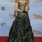 Pop star/director Madonna poses backstage with the award for Best Original Song in a Motion Picture for the song Masterpiece from her Wallis Simpson film W.E. (AP Photo/Mark J Terrill/PA Images)