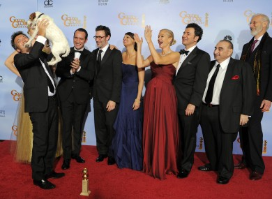 Uggie the dog joins other crew and cast members from The Artist to celebrate last night's award wins.