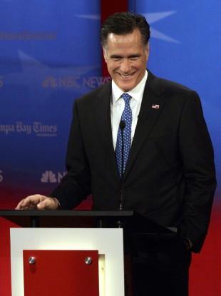 Romney smiles during a debate in Tampa, Florida last night.