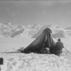A photograph taken by Scott of Dr Edward Wilson sketching at Beardmore Glacier on 13 December 1911. (Courtesy of Scott Polar Research Institute, University of Cambridge)