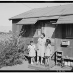 Mrs Naguchi and two young girls standing at the entrance of a dwelling. (Library of Congress, Prints & Photographs Division)
