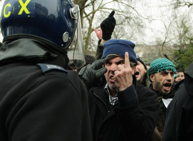 Anti-Assad protesters clash with police outside the Syrian Embassy in London.
