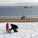 Making a snowman on the beach in Scarborough, Yorkshire, following heavy snow across the UK overnight. (John Giles/PA Wire)