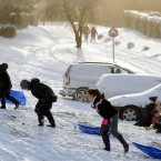 Children enjoy the snow at Rillington, near Malton, England. (John Giles/PA Wire)