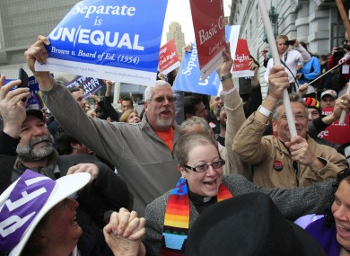 Supporters of gay marriage react outside the court today