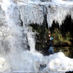 Walker Mark Proud looks at the mostly-frozen waterfall at Gibson's Cave at Bowlees, Middleton-in-Teesdale, England. Image: Owen Humphreys/PA Wire