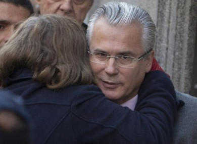 An unidentified woman embraces Spanish judge Baltazar Garzon as he arrives at the Supreme Court in Madrid on 31 January.