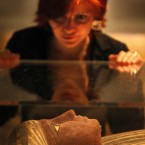 National Museum of Scotland staff member Henrietta Lidchi with one of the new Egyptian mummies on display in Edinburgh. Image: David Cheskin/PA Wire