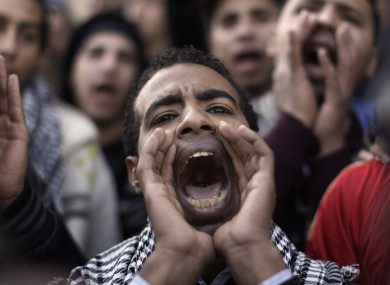 A student protester shouts anti-military slogans in Cairo today.