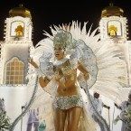 A dancer from the Imperatriz samba school sings in the Sambadrome yesterday during the first part of the two-day parade. (AP Photo/Victor R Caivano/PA Images)