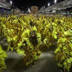 Revelers dance during Beija Flor samba school parade. (AP Photo/Victor R Caivano/PA Images)