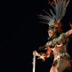 A dancer performs atop a float during Vila Isabel samba school parade. (AP Photo/Victor R Caivano/PA Images)