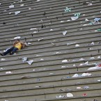 The morning after... A man sleeps in the litter-filled stands at the end of the first day of the Sambadrome parades. (AP Photo/Victor R Caivano/PA Images)