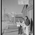 (L to R) Roy Takeno, Yuichi Hirata and Nabou Samamura stand in front of the Office of Reports Free Press reading the Los Angeles Times. (Library of Congress, Prints & Photographs Division)
