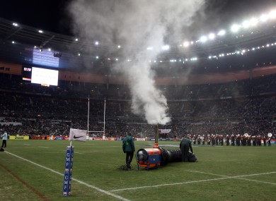 Stadium staff try to defrost the Stade de France pitch before the France v Ireland rugby international was called off.