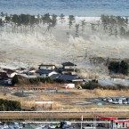 The massive tsunami engulfs a residential area after a powerful earthquake in Natori, Miyagi Prefecture in north-eastern Japan on 11 March, 2011. (Kyodo/PA Images)