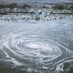 A Kyodo News helicopter captured this photo of a whirlpool caused by the tsunami near a port in Oarai, Ibaraki Prefecture on March 11, 2011. (Kyodo/PA Images)
