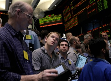 Traders work in the energy options pit at the New York Mercantile Exchange in New York yesterday as the price of oil reached its highest since July 2008.