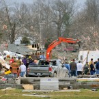 Emergency responders work to clear debris in a neighbourhood in Harrisburg, Illinois, after an early morning tornado. (AP Photo/Stephen Lance Dennee/PA Images)