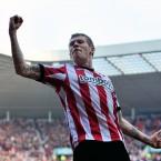 One-footed wonder James McLean celebrates scoring Sunderland's second goal against Premier League strugglers QPR.<span class=