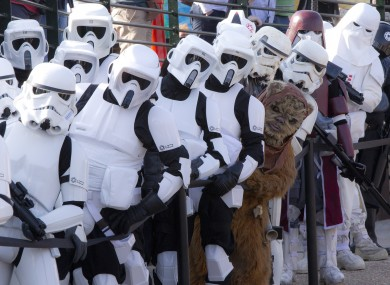 Imperial Stormtroopers and an Ewok stand in line at the Star Wars Legoland Experience in England today