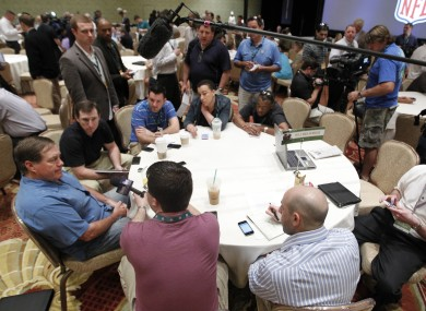 New England Patriots coach Bill Belichick talks to the media at an NFL owners day.