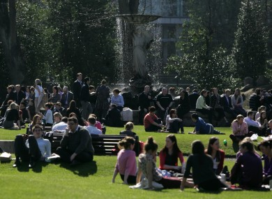 Office workers enjoying the sun at the Iveagh Gardens
