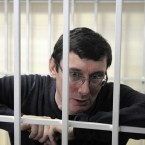 Former Ukrainian Interior Affair Minister Yuriy Lutsenko is seen in a detention cage in a courtroom, in Kiev, Ukraine in February 2012. Yuriy Lutsenko will stay in jail for two years and ten months since he has already been under arrest for one year and two months.(AP Photo/Sergei Chuzavkov)