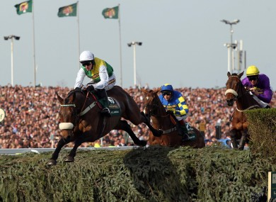 Ballabriggs, ridden by Jason Maguire, clears the water jum goes on to win the Aintree Grand National