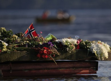 Flowers laid close to Utoya island in memory of the attack victims.