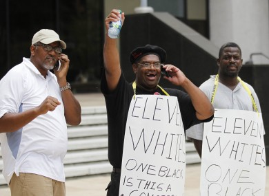 Demonstrators react as they found out the five police officers were convicted of the shooting last year