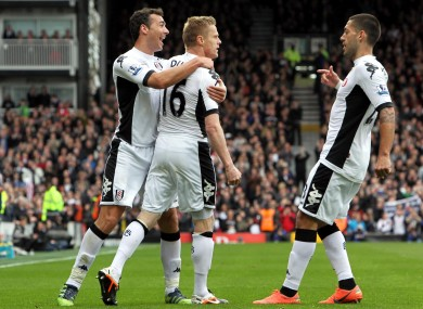 Duff is congratulated by Stephen Kelly (left) and Clint Dempsey.